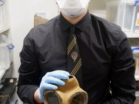 work experience student Lukasz in The Devils Porridge Museum object store